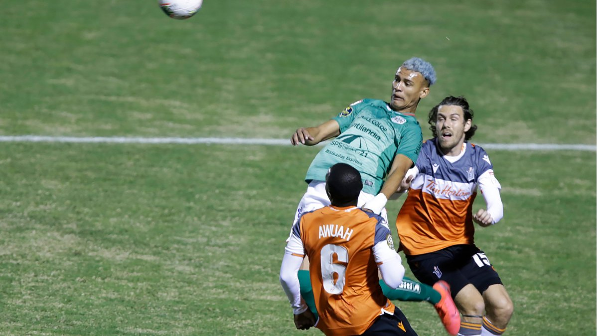 Forge FC and C.D. Marathon players battle during a Concacaf League Play-In Round match in Tegucigalpa, Honduras in this Tuesday, December 8, 2020 handout photo. THE CANADIAN PRESS/HO, CONCACAF .