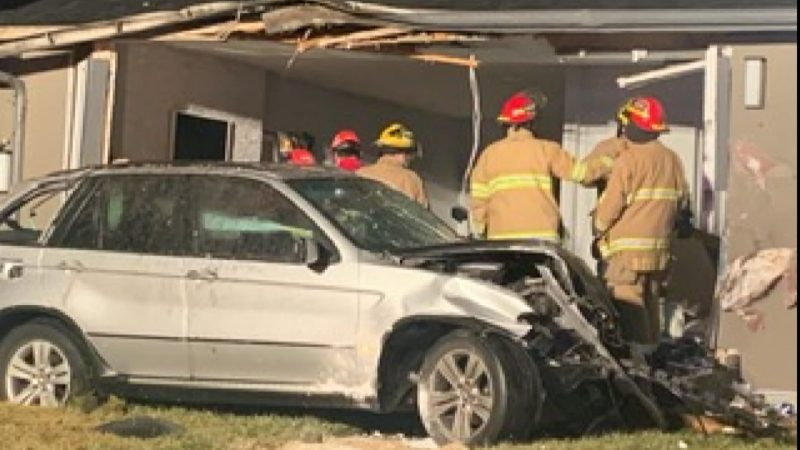 Emergency crews investigate after a vehicle crash into a home at 2055 33 Street Southeast.