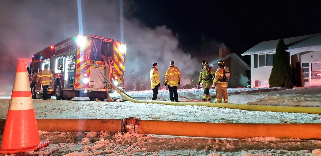 Edmonton fire crews battle a blaze in a house in the area of 93 Avenue and 72 Street Thursday, Dec. 3, 2020.