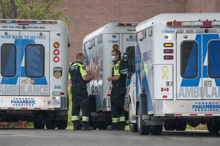 Paramedics stand by their ambulances at Toronto Western Hospital in Toronto on Tuesday October 27, 2020.