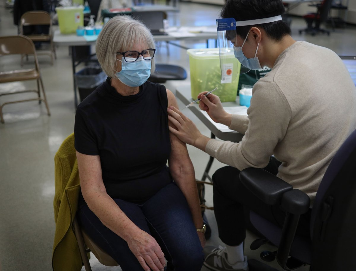 RN Sharon Dunn receives the COVID-19 vaccine in Calgary Jan. 22, 2021.