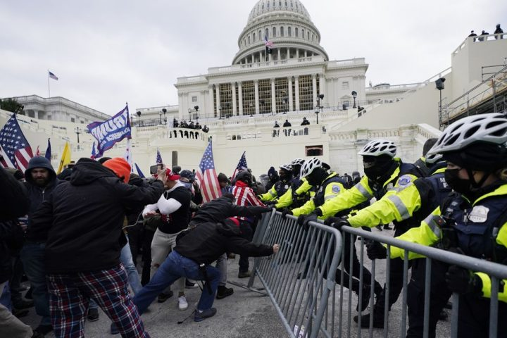 'Democracy survived' in U.S. Capitol riot because of police, Biden says