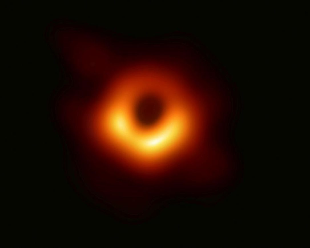 This image provided Wednesday, April 10, 2019, by Event Horizon Telescope, shows a black hole.