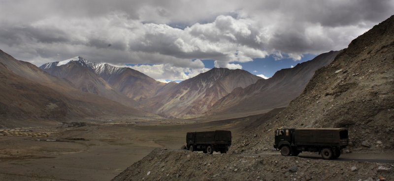 FILE- In this Sept. 14, 2017, file photo, Indian army trucks drive near Pangong Tso lake near the India China border in India's Ladakh area. The Indian army said Saturday, Jan. 9, 2020, that it has apprehended a Chinese soldier in the remote Ladakh region, where the two countries are locked in a monthslong military standoff along their disputed mountain border. An army statement said the Chinese soldier was taken into custody on Friday for transgressing into the Indian side in area South of Pangong Tso lake.