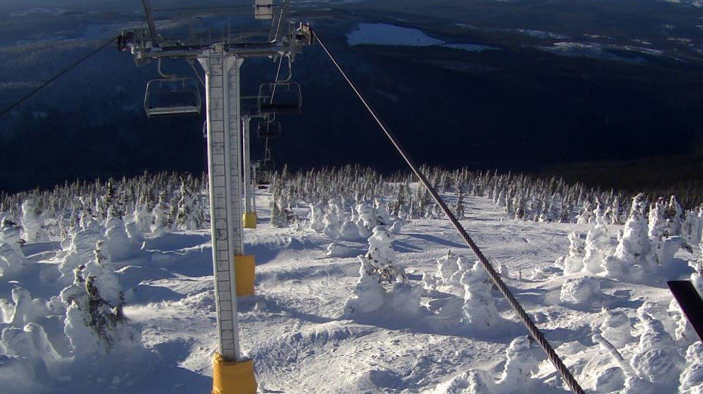 A webcam view from the Gem Lake chairlift at Big White Ski Resort.