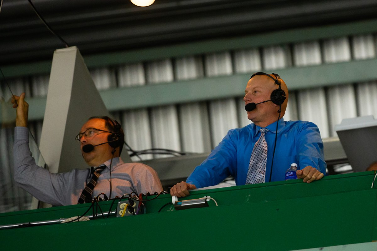 Cam Moon, right, calls a game for the Red Deer Rebels.