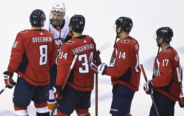 Washington Capitals left wing Alex Ovechkin (8) shakes hands with New York Islanders right wing Leo Komarov (47) after being eliminated during third period NHL Eastern Conference Stanley Cup playoff hockey action in Toronto on Thursday, August 20, 2020.