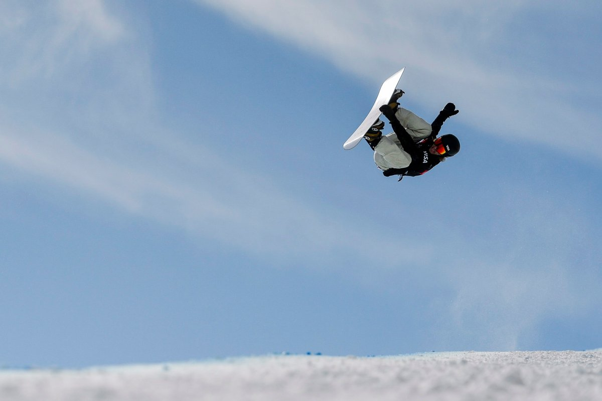 Patrick Burgener, of Switzerland, competes in the men's snowboard halfpipe final at the freestyle ski and snowboard world championships, Friday, Feb. 8, 2019, in Park City, Utah. (AP Photo/Alex Goodlett).