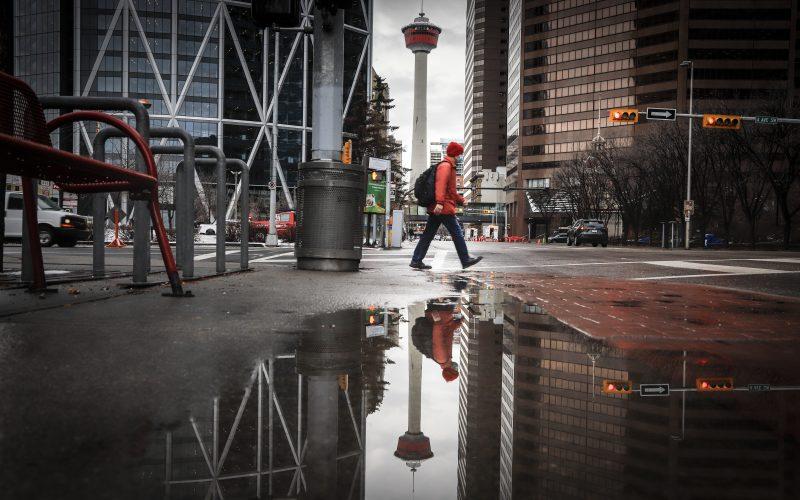 A pedestrian wearing a mask walks through an empty downtown Calgary, Alta., Wednesday, Dec. 9, 2020,.