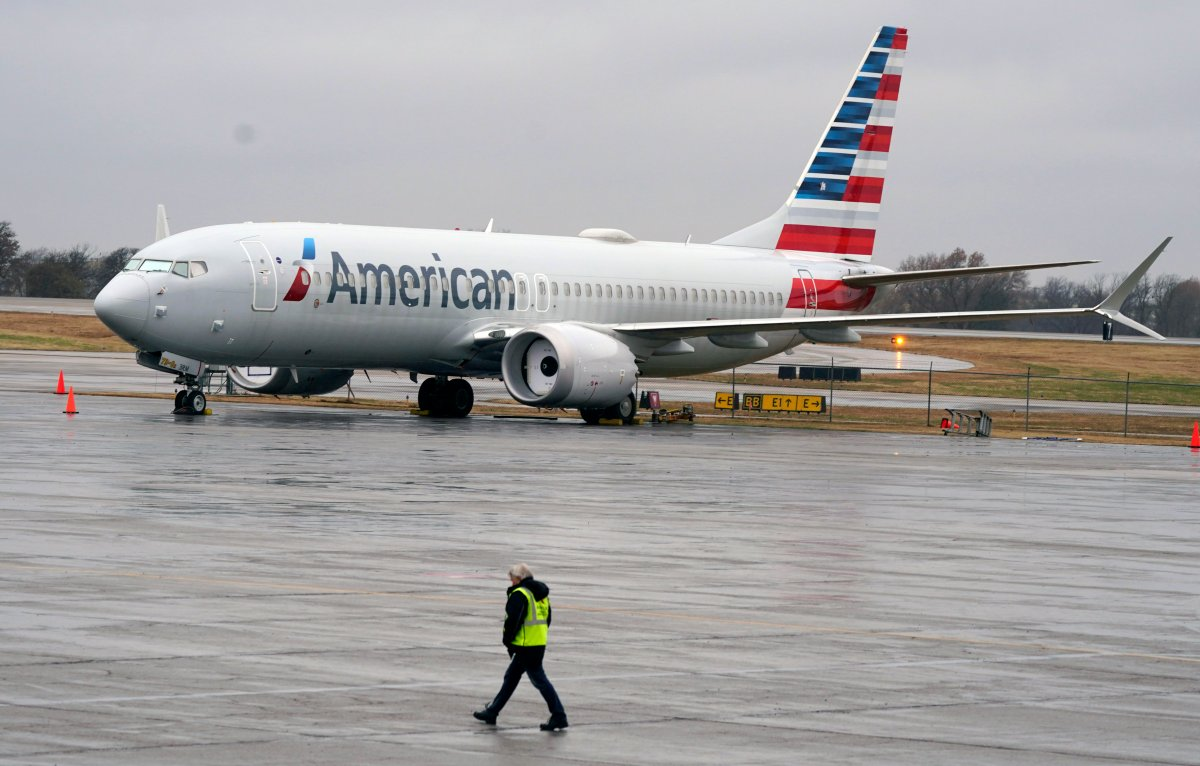 FILE - In this Dec. 2, 2020 file photo, an American Airlines Boeing 737 Max jet plane is parked at a maintenance facility in Tulsa, Okla.