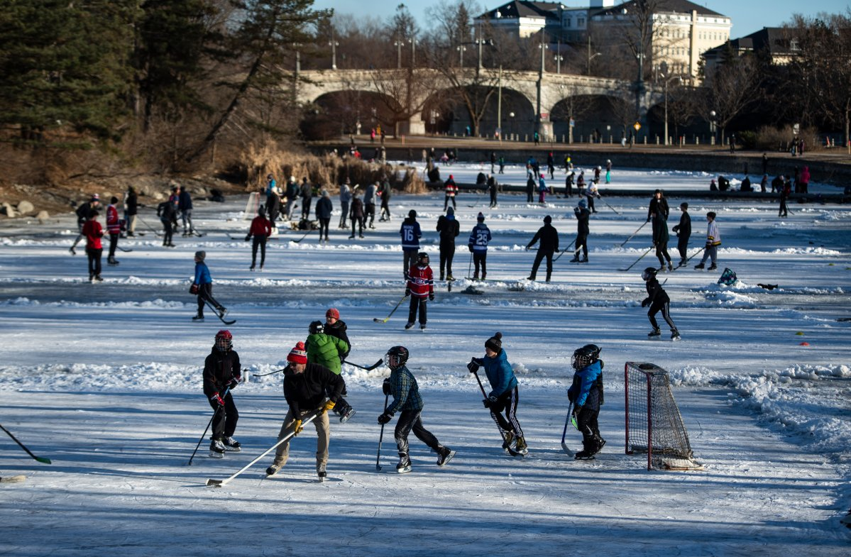 People play pond hockey on Brown's Inlet in Ottawa, on Tuesday, Dec. 29, 2020.