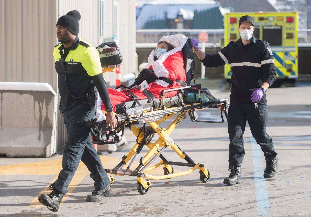 Paramedics transfer a woman into a hospital in Montreal, Saturday, January 2, 2021, as the COVID-19 pandemic continues in Canada and around the world.