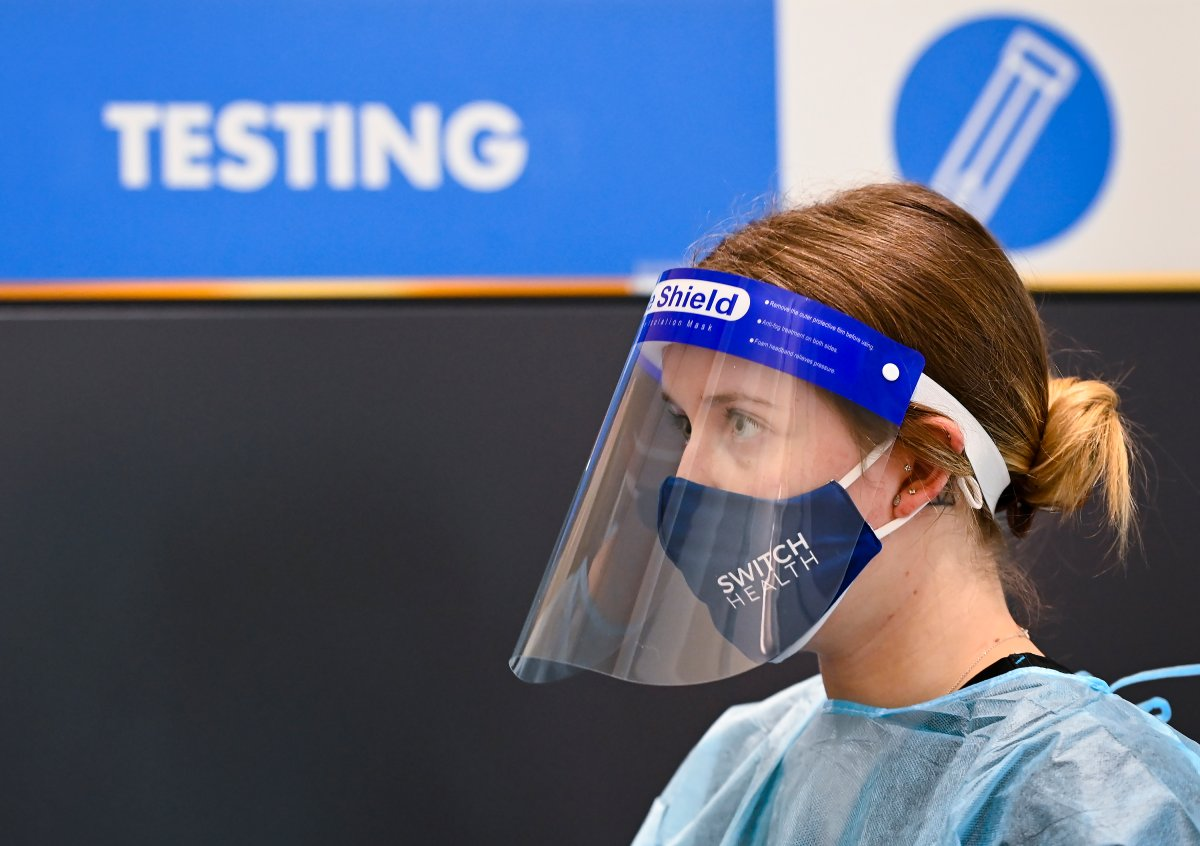 Hailey Knott, nurse operations manager, waits at a COVID-19 testing station located at the international arrivals area at Pearson International Airport in Toronto on Wednesday, Jan. 6, 2021.