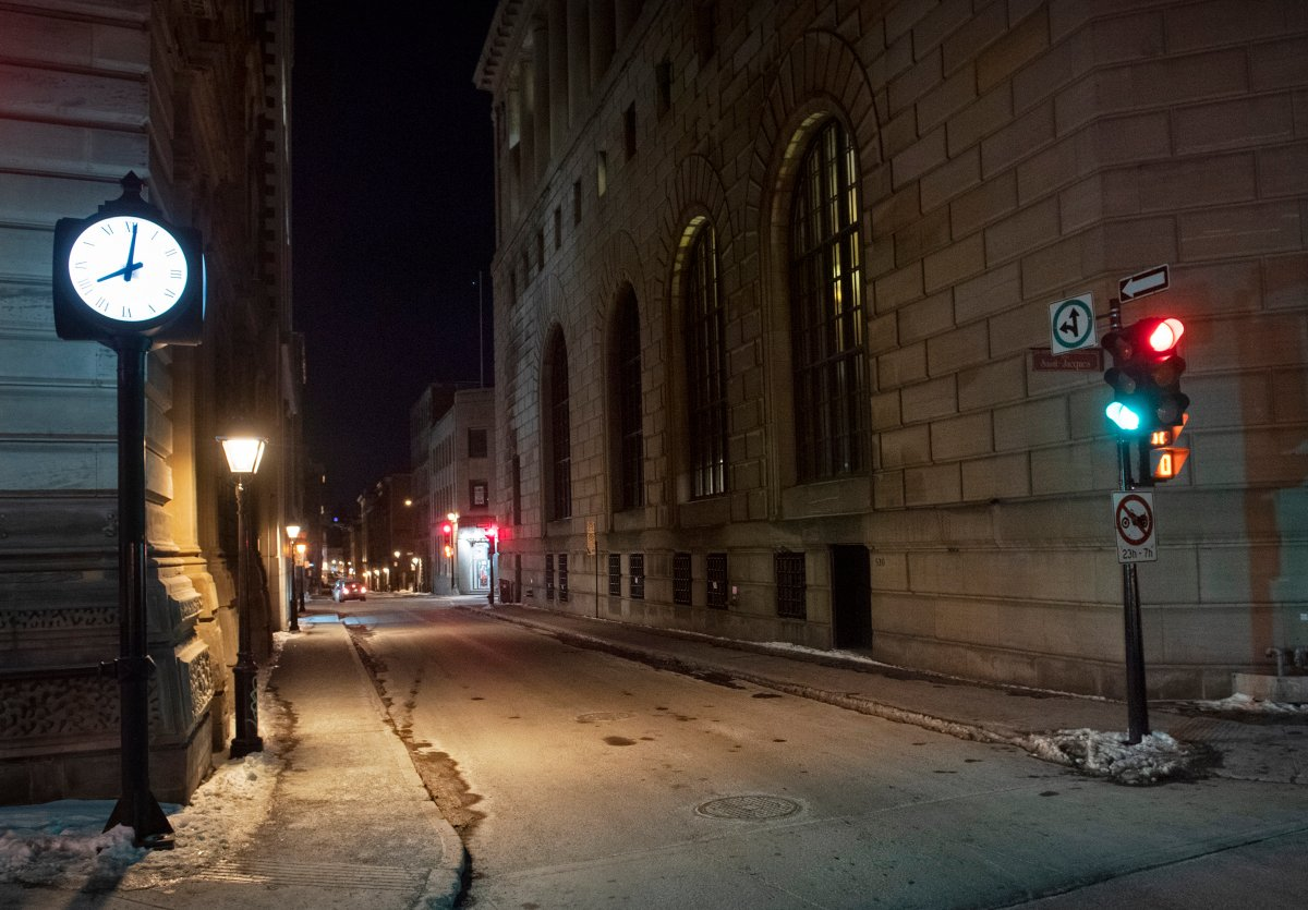 A clock reading 8 p.m is shown on the corner of an empty street in Montreal, Saturday, January 9, 2021, as the COVID-19 pandemic continues in Canada and around the world. The Quebec government has imposed a curfew to help stop the spread of COVID-19 starting at 8 p.m until 5 a.m and lasting until February 8.