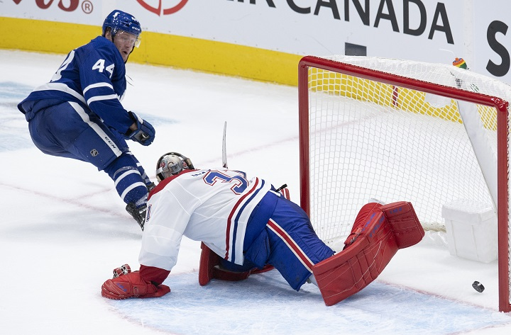 Toronto Maple Leafs defenceman Morgan Rielly (44) scores the game winning goal on Montreal Canadiens goaltender Carey Price (31) during overtime NHL action in Toronto, Wednesday, Jan. 13, 2021. THE CANADIAN PRESS/Frank Gunn.