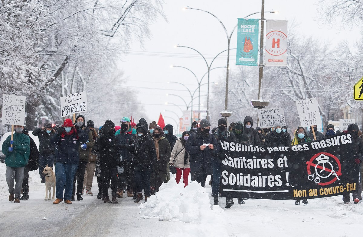 People participate in a demonstration opposing restrictions imposed by the Quebec government to help stop the spread of COVID-19 in Montreal, Saturday, January 16, 2021, as the pandemic continues in Canada and around the world. The Quebec government has imposed a lockdown and a curfew to help curb the spread of COVID-19. The curfew begins at 8 p.m until 5 a.m and lasting until February 8.