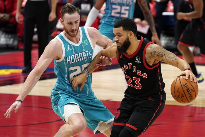 Toronto Raptors guard Fred VanVleet (23) works against Charlotte Hornets forward Gordon Hayward (20) during the first half of an NBA basketball game Saturday, Jan. 16, 2021, in Tampa, Fla.