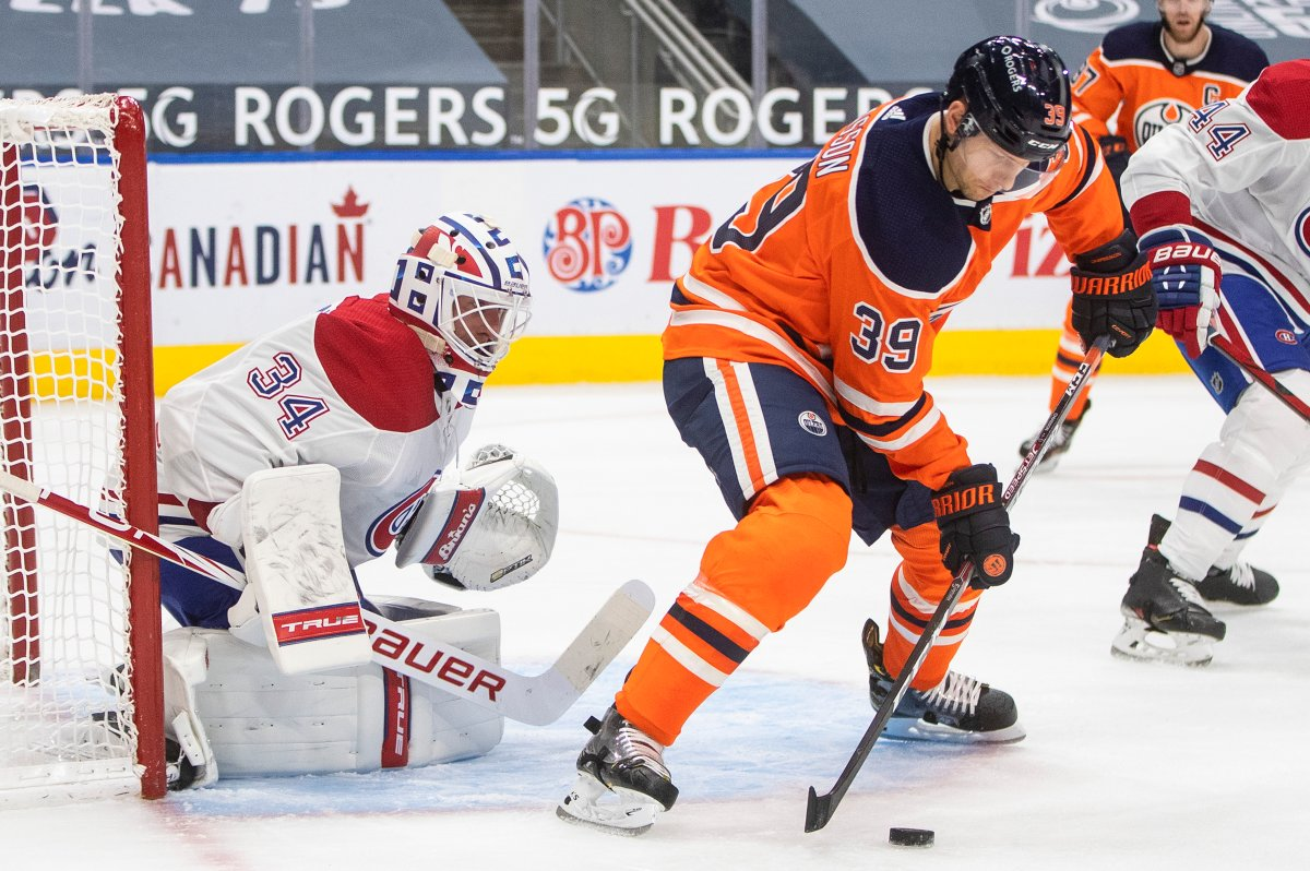 Edmonton Oilers' Alex Chiasson (39) tries to tip the puck in past Montreal Canadiens goalie Jake Allen (34) during second period NHL action in Edmonton on Monday, January 18, 2021.