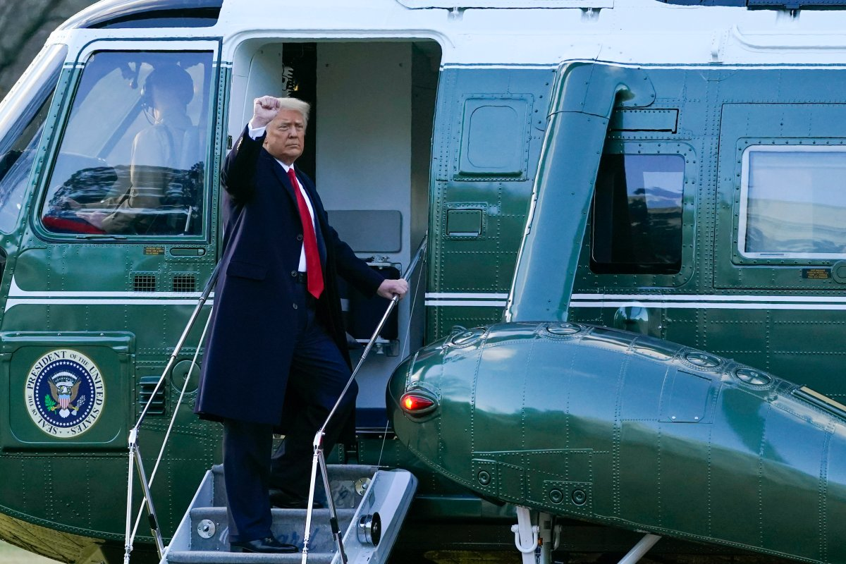 President Donald Trump gestures as he boards Marine One on the South Lawn of the White House, Wednesday, Jan. 20, 2021, in Washington. Trump is en route to his Mar-a-Lago Florida Resort. (AP Photo/Alex Brandon).