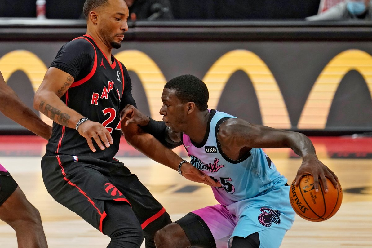 Miami Heat guard Kendrick Nunn (25) pushes off Toronto Raptors guard Norman Powell (24) as he drives up the court during the second half of an NBA basketball game Wednesday, Jan. 20, 2021, in Tampa, Fla.