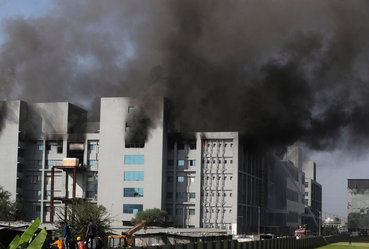 Firemen try to douse a fire at Serum Institute of India, the world's largest vaccine maker that is manufacturing the AstraZeneca/Oxford University vaccine for the coronavirus, in Pune, India, Thursday, Jan. 21, 2021.