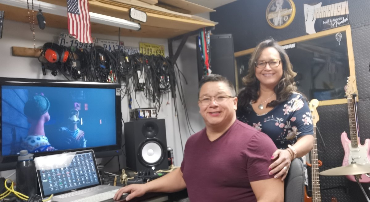 Tom and Carol Anne Johnson are pictured in their home recording studio in Cape Breton, Nova Scotia in a handout photo. Nearly a decade after the two Nova Scotia residents dubbed over a stop motion animated film in Mi'kmaq, people continue to express their interest in the unique version of the adventure comedy.