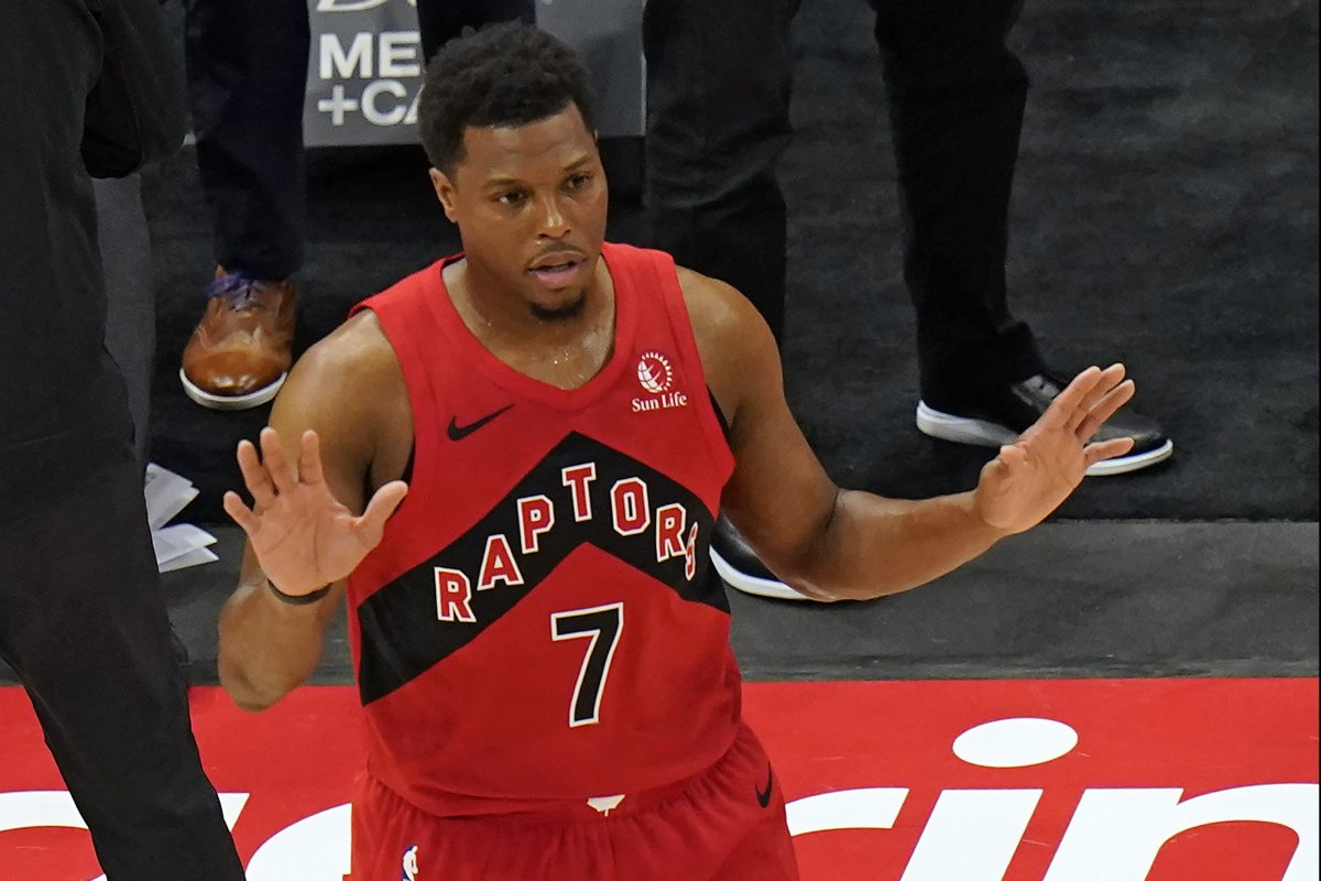 Toronto Raptors guard Kyle Lowry (7) reacts to a basket during the first half of an NBA basketball game against the Milwaukee Bucks Wednesday, Jan. 27, 2021, in Tampa, Fla. The basket put Lowry over the 10,000 point mark as a member of the Raptors.