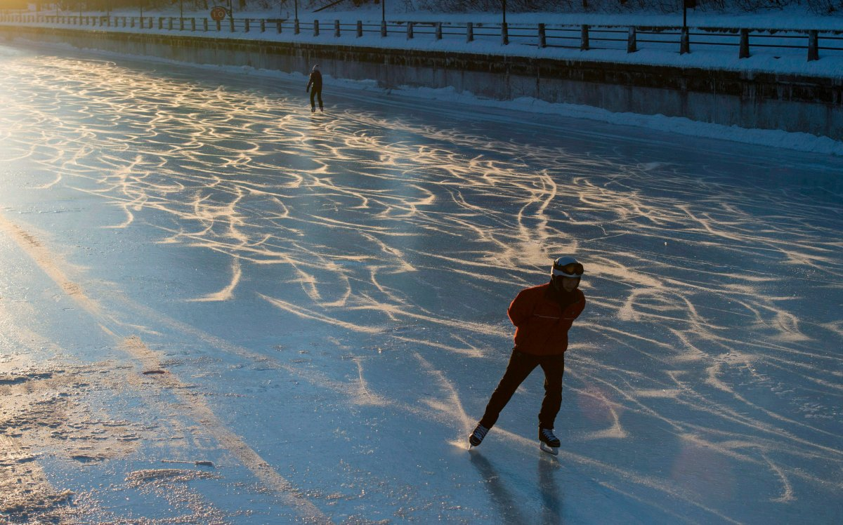 "Skaters make their way along the Rideau Canal Skateway shortly after dawn on Sunday, Jan. 15, 2017 in Ottawa. The skateway will open for its 51st season ""early next week,"" the NCC's chief executive said Thursday."