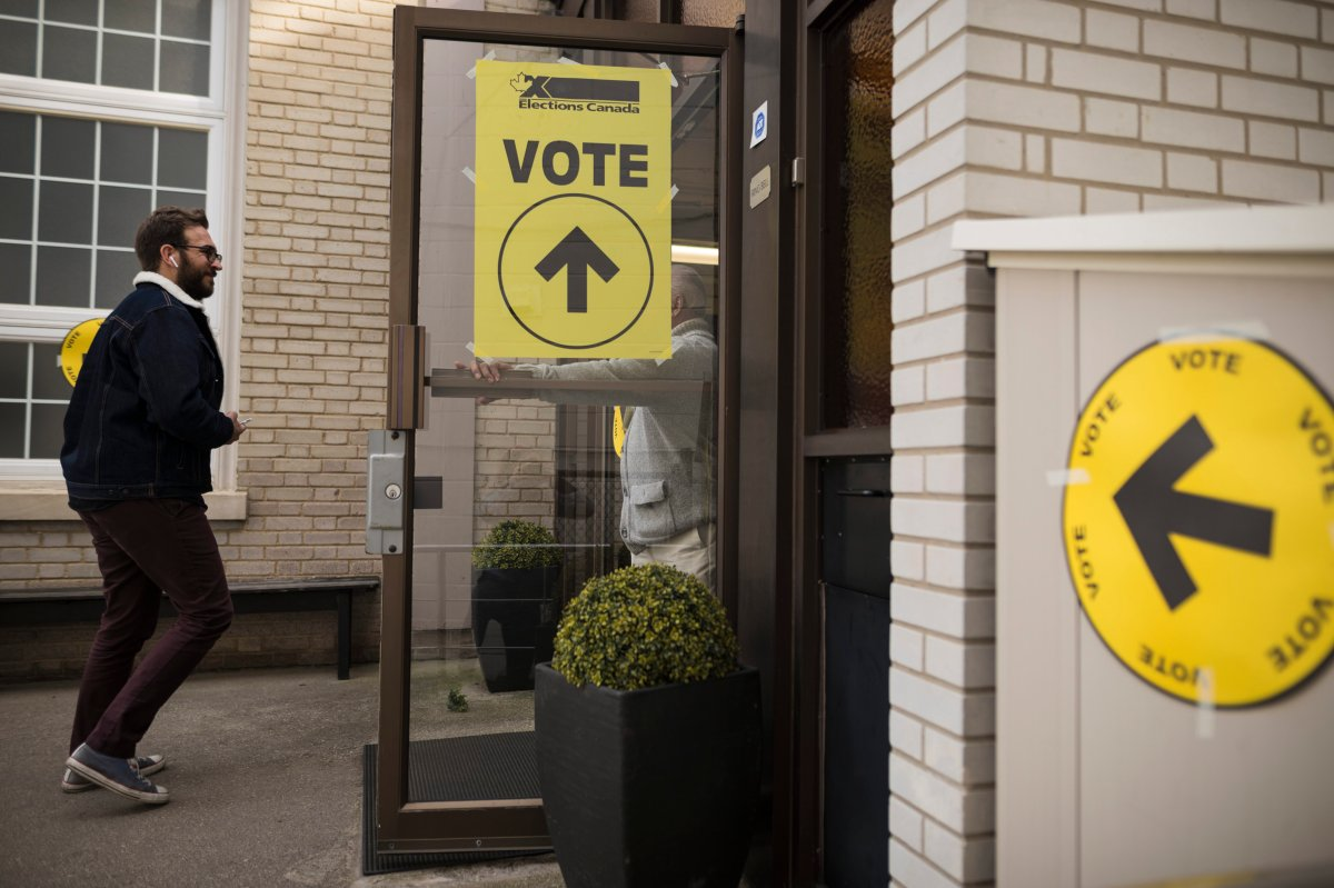 A voter makes their way towards the polling station at  West Toronto Baptist Church during election day in Toronto on Monday, Oct. 21, 2019.