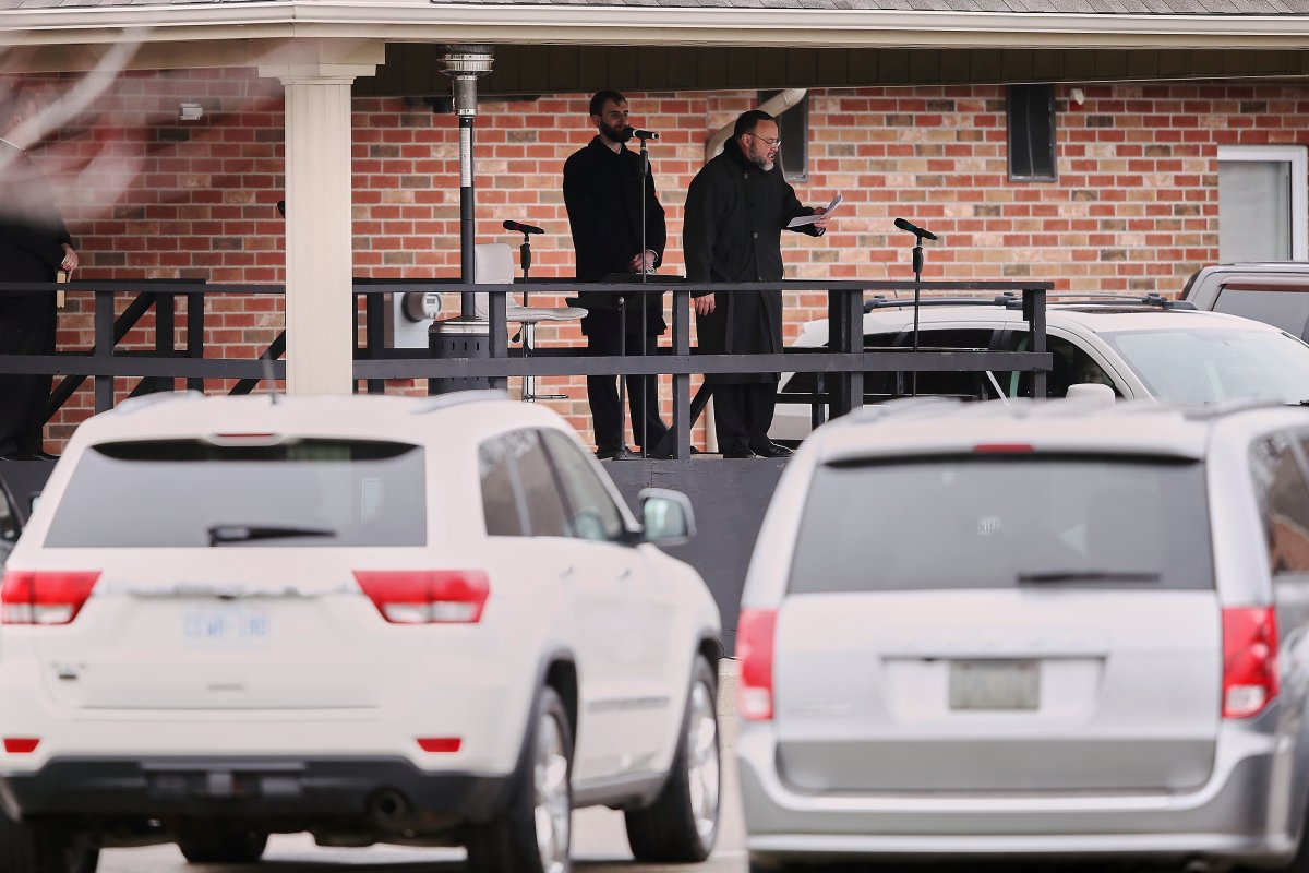 FILE - Pastor Henry Hildebrandt speaks during a drive-in Sunday service at The Church of God in Aylmer, Ont. on Sunday, April 26, 2020.