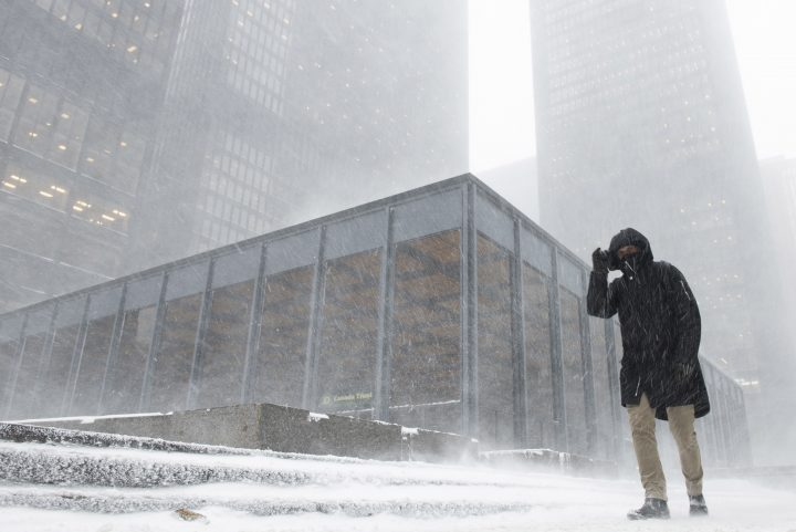 A pedestrian braves blowing snow as a storm moved in Toronto on Monday, January 28, 2019.