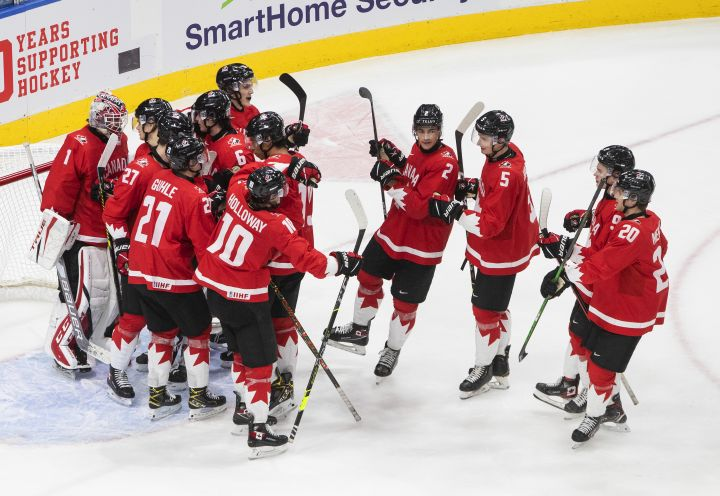 Canada celebrates the win over Russia at the end of the third period IIHF World Junior Hockey Championship action in Edmonton on Monday, January 4, 2021.
