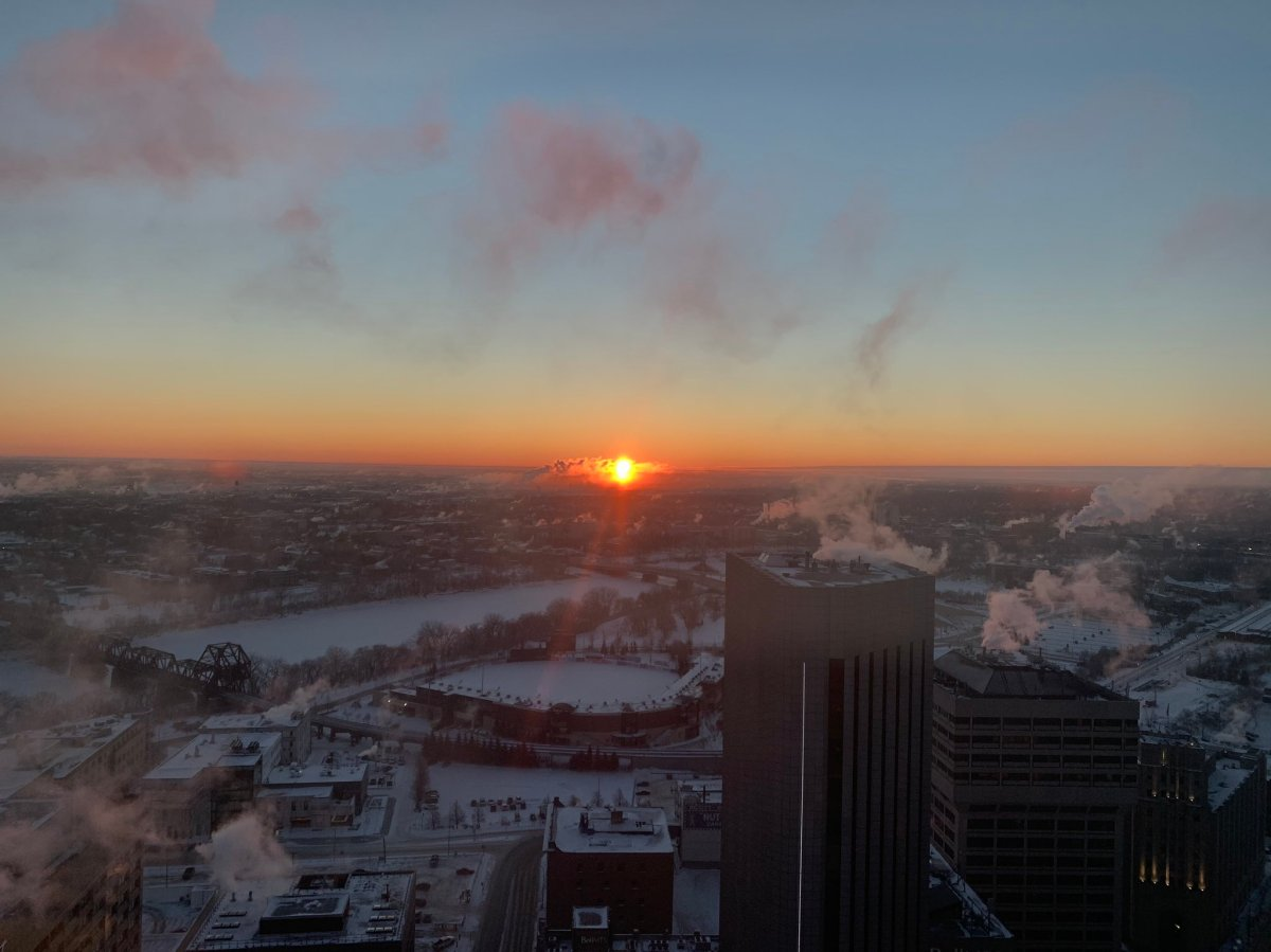 The sun rises on a frosty morning in Winnipeg on Tuesday, Jan. 26, 2021.