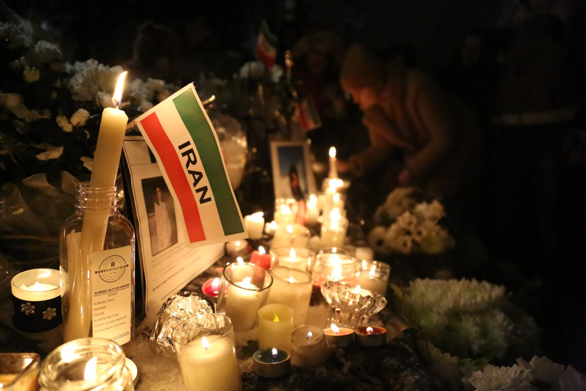"People attend the ""Seventh Day Vigil"" for Iran plane crash victims at Civic Plaza in front of North Vancouver City Hall, B.C., Canada on January 14, 2020. A candlelight memorial held in honour of people lost aboard Flight 752."
