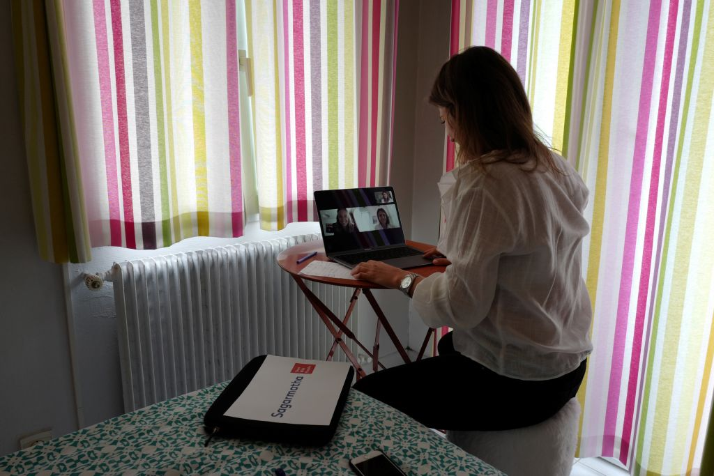 Manon, employee of global PR group Sagarmatha - Hopscotch, connects with her colleagues in Paris via videochat at her home office (teletravail) in the French riviera city of Nice, southern France, on May 15, 2020, a few days after France eased lockdown measures taken to curb the spread of the COVID-19 pandemic, caused by the novel coronavirus. (Photo by VALERY HACHE / AFP) (Photo by VALERY HACHE/AFP via Getty Images).