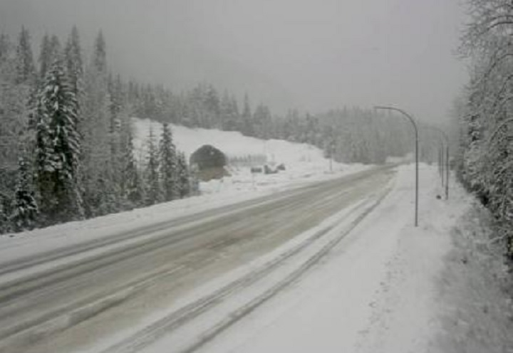 A DriveBC highway camera image showing snowy conditions on the Trans-Canada Highway at Albert Canyon, east of Revelstoke, on Sunday. Environment Canada is telling motorists to prepared for more snow on the high mountain passes Sunday night.