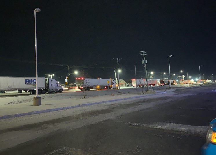 Truckers wait for Highway 1 to reopen after it was closed due to poor road conditions.