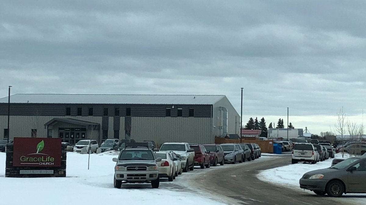The crowded parking lot of Grace Life Church Of Edmonton in Parkland County, on Sunday, January 17, 2021.