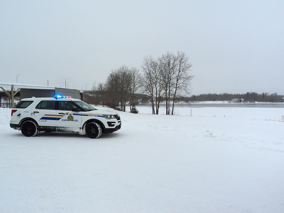 Grand Rapids RCMP at the scene where a man was rescued from the Saskatchewan River Wednesday.