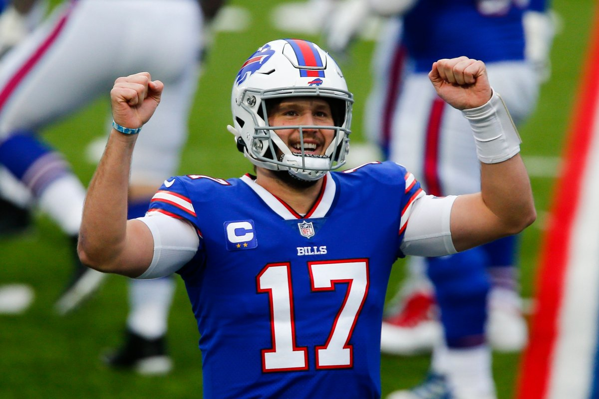 Buffalo Bills quarterback Josh Allen (17) reacts after throwing a touchdown pass in the first half of an NFL football game against the Miami Dolphins, Sunday, Jan. 3, 2021, in Orchard Park, N.Y.