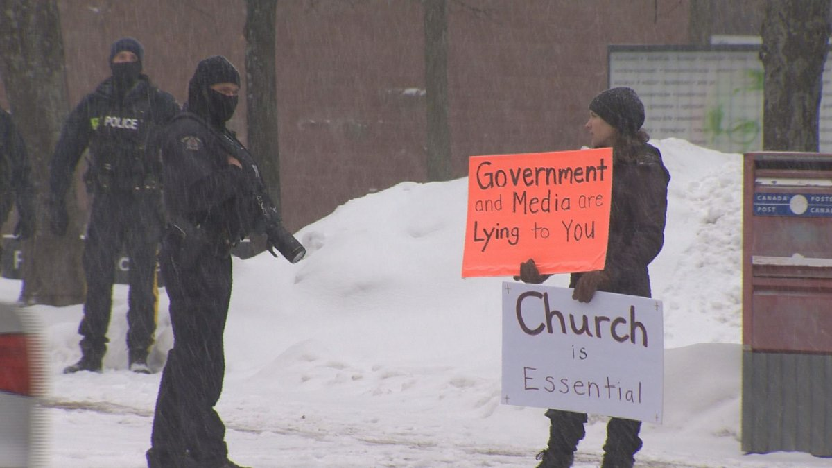 A protestor is seen at an anti-mask rally outside of city hall in Moncton, N.B.