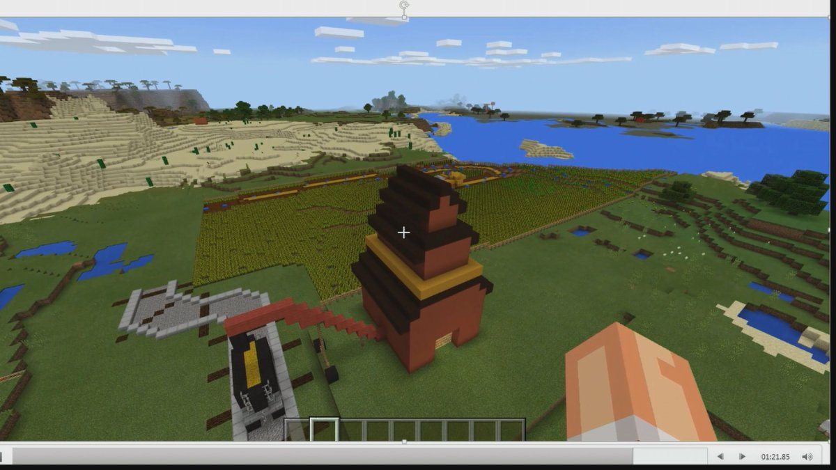 A screenshot shows a Minecraft player at work building a digital world.
