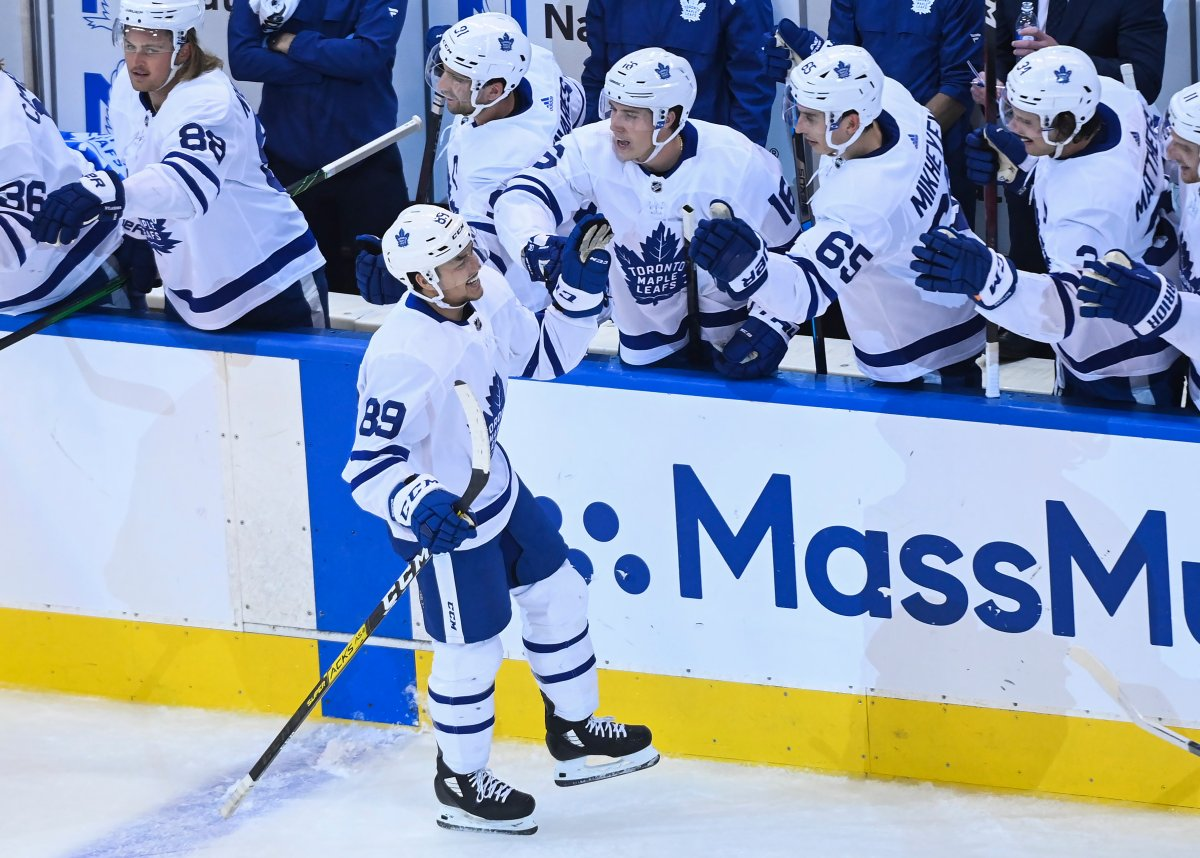 Toronto Maple Leafs left wing Nicholas Robertson (89) celebrates his first NHL goal with teammates during second period NHL Eastern Conference Stanley Cup playoff action against the Columbus Blue Jackets, in Toronto, Thursday, Aug. 6, 2020.