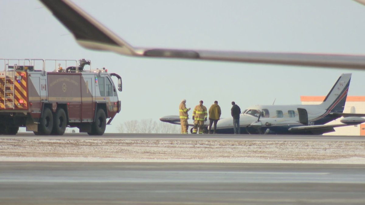 A private Piper aircraft landed on Regina International Airport's main runway without deploying its landing gear on Tuesday morning.