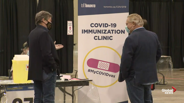 Toronto Mayor John Tory and Premier Doug Ford tour a COVID-19 vaccination clinic at the Metro Toronto Convention Centre on Sunday.