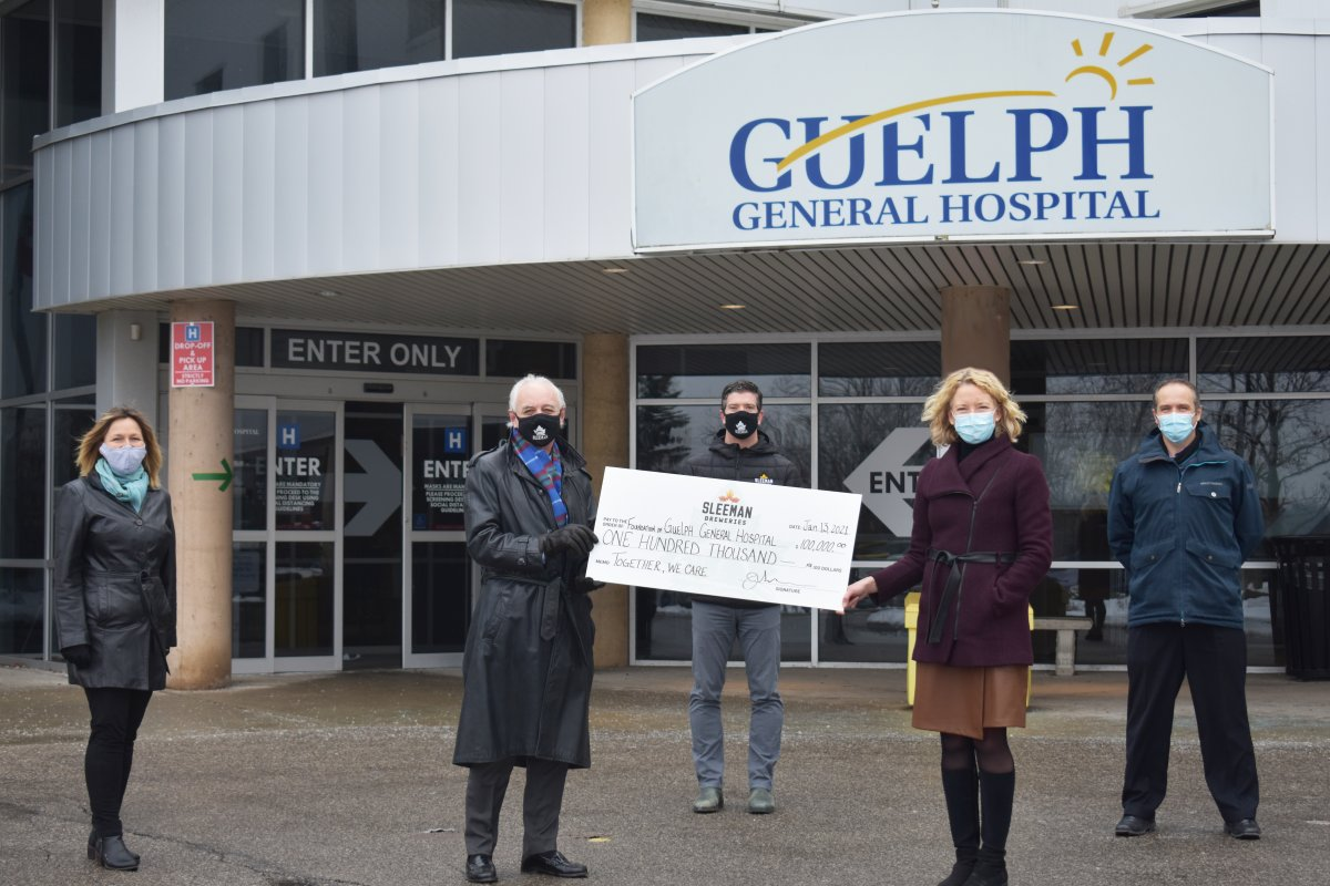 Sleeman Breweries presents a cheque for $100,000 to Guelph General Hospital.