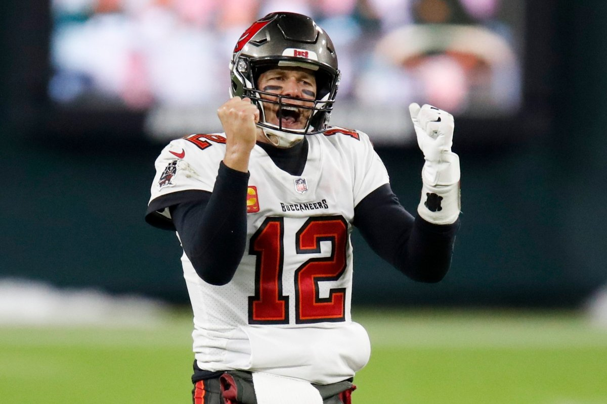 Tampa Bay Buccaneers quarterback Tom Brady reacts after winning the NFC championship game against the Green Bay Packers in Green Bay, Wis., Sunday, Jan. 24, 2021. The Buccaneers defeated the Packers 31-26 to advance to the Super Bowl.