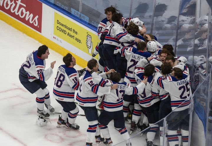 United States celebrate their win over Canada in IIHF World Junior Hockey Championship gold medal game action in Edmonton on Tuesday, January 5, 2021.