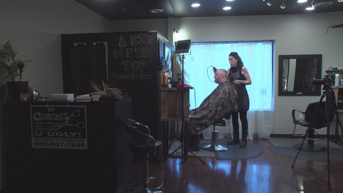 Alicia Hirter, owner of Chrome Artistic Barber, working at her salon in St.Catharines. Hirter's storefront now includes cameras, microphones and production lighting for auditions. The idea is to operate as a film or TV set, since those are exempt from Ontario's lockdown rules.