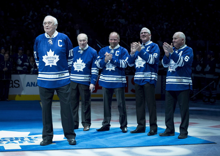 Toronto Maple Leafs alumni applaud fellow alumni George Armstrong, left, during a pre-game ceremony before the Toronto Maple Leafs and Winnipeg Jets NHL game in Toronto on Saturday, February 21, 2015. The Toronto Maple Leafs announced that former players Armstrong and Syl Apps will be added to the team's Legends Row.